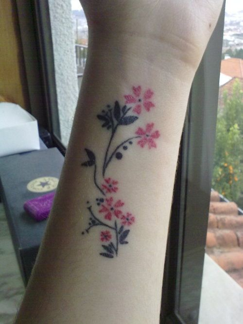 Small cherry blossom branch tattoo on wrist for Cherry blossom tattoo wrist