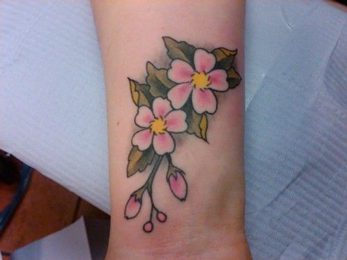 Small cherry blossom tattoo of flowers on wrist for Cherry blossom tattoo wrist