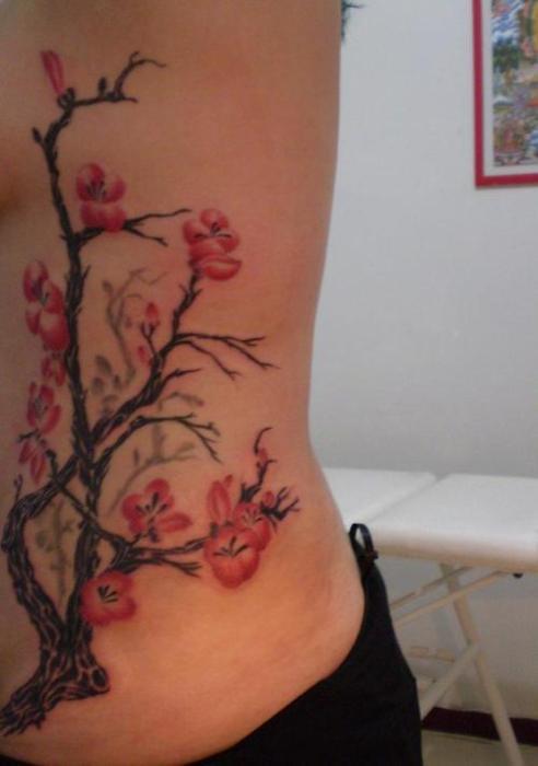 Women 39 s side cherry blossom flower tattoo for Flower side tattoo
