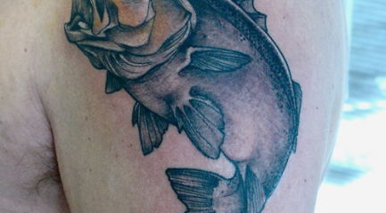 Bass fish tattoo on guys upper arm
