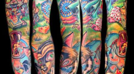 Colorful full sleeve tattoo w/ animals and nature scene