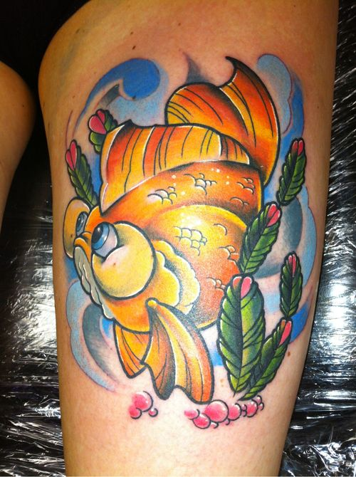 Large cute goldfish tattoo on girls thigh