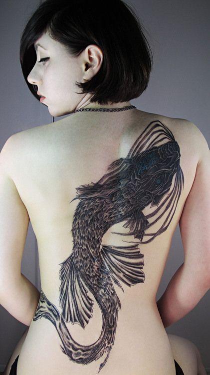 Large Japanese carp fish tattoo on girls back