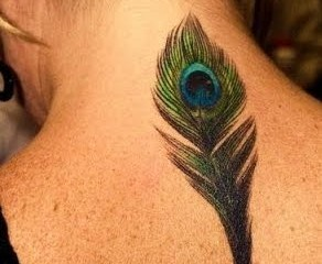 Peacock feather tattoo on girls back