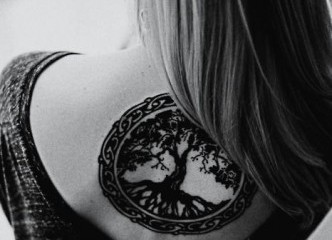 Awesome Celtic tree of life tattoo on girls back