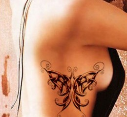 Celtic knot butterfly tattoo on girls side