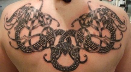Celtic knots and dragons tattoo on guys back