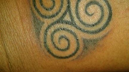 Celtic trinity swirls tattoo