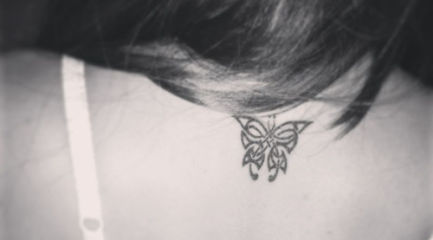 Cute Celtic butterfly on back of girls neck