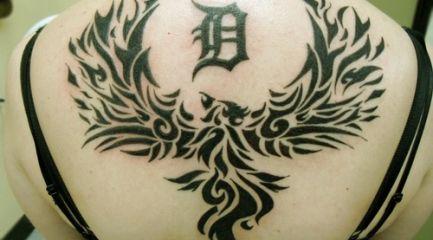 Girls huge tribal phoenix tattoo on her back