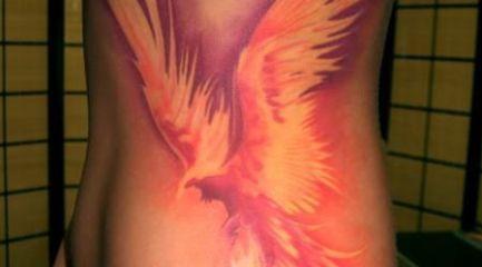 Girls side Phoenix on fire tattoo
