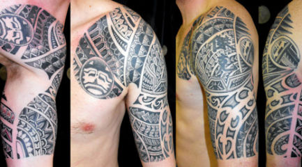 Guys Polynesian chest and half sleeve tattoo