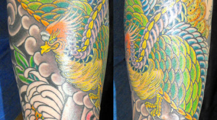 Japanese phoenix in guys sleeve tattoo