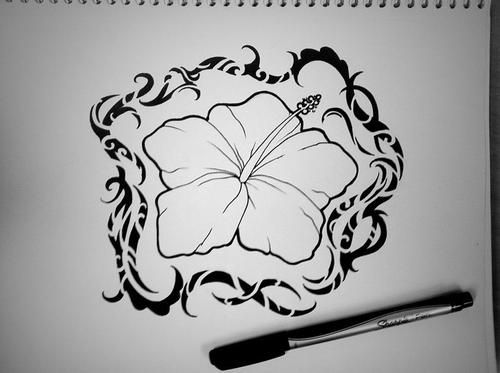 Polynesian style hibiscus flower tattoo design