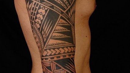 Polynesian three-quarter tribal sleeve tattoo