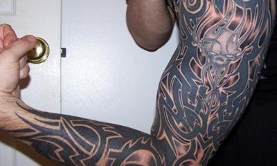 Tribal Celtic full sleeve tattoo with skull