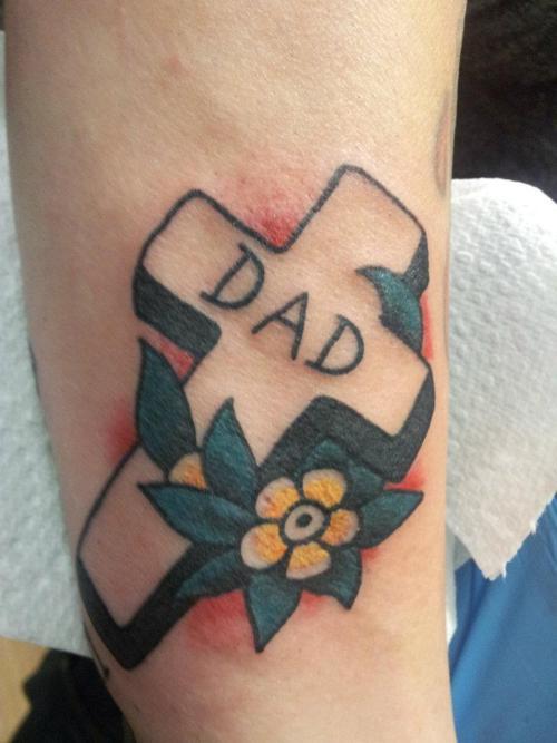 3D memorial flower & cross tattoo on arm