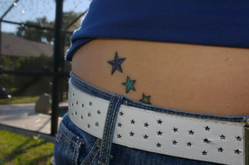 Purple nautical star tattoo on waist for Star tattoos on hips meaning