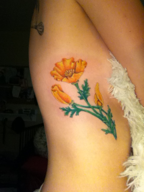 california poppy flower rib tattoo. Black Bedroom Furniture Sets. Home Design Ideas