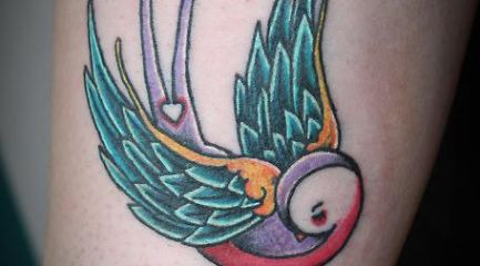 Multiple color swallow tattoo w heart