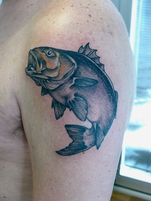 Bass fish tattoo on guys upper arm