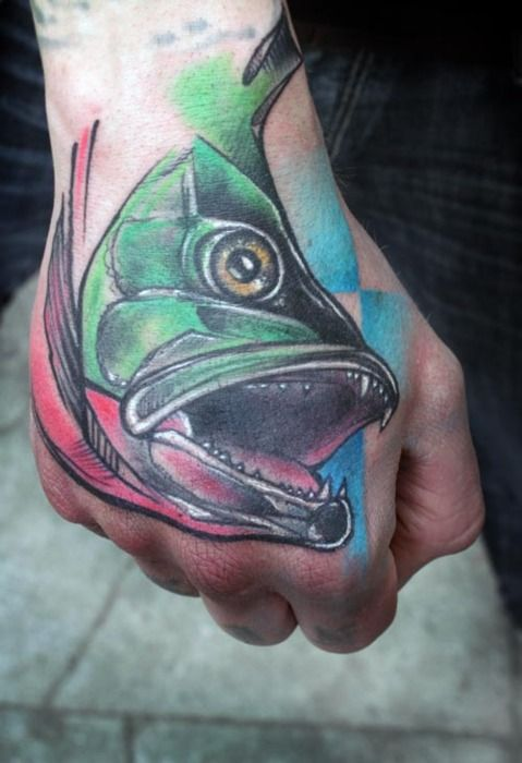 Colorful fish hand tattoo