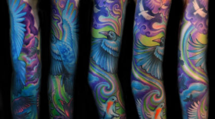 colorful full sleeve w. swirls, clouds, and birds