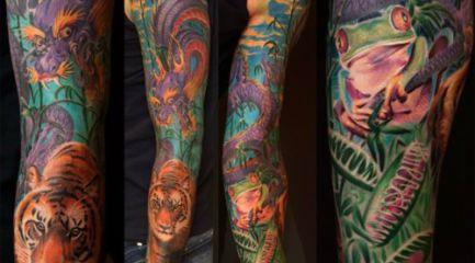 Colorful jungle scene sleeve tattoo