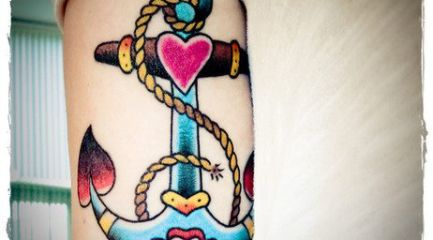 Colorful old school anchor tattoo with heart