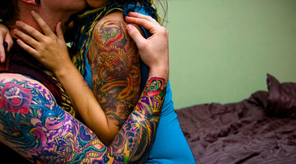 Couples colorful sleeve tattoos