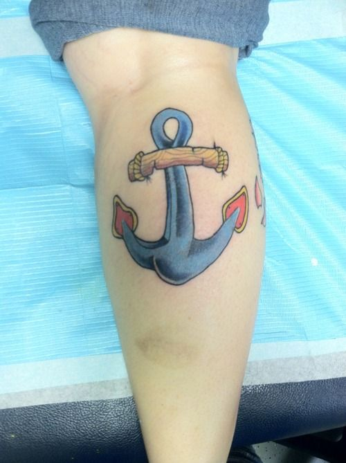 Funky traditional anchor tattoo on leg