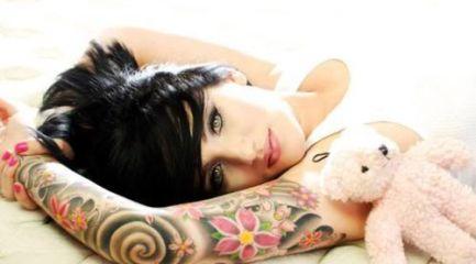 Girls full sleeve tattoo w/ Japanese waves and flowers
