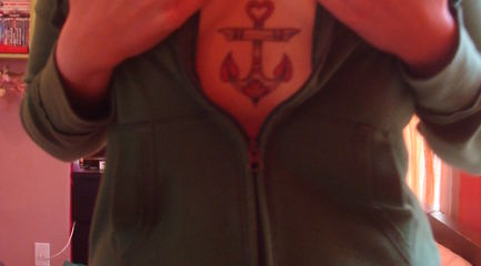 Girls traditional chest anchor tattoo with heart