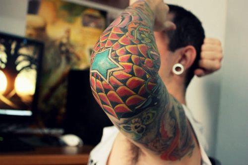 Guys full sleeve tattoo w/ spider web, star, and skulls