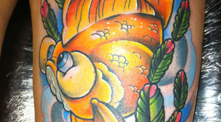 Large cute goldfish tattoo on girls thigh