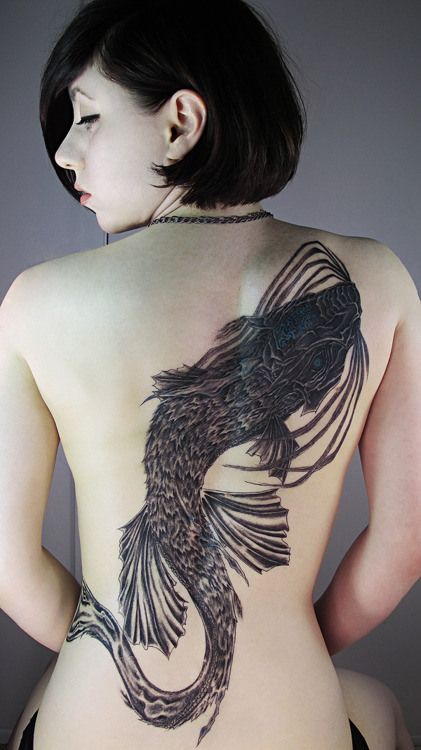 Large Japanese carp fish tattoo on girls back