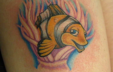 Silly girly clown fish tattoo