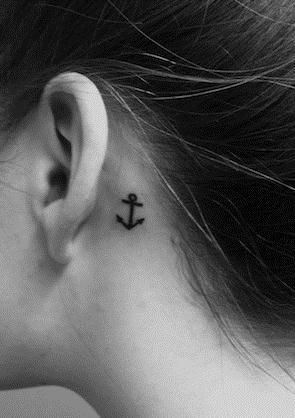 Tiny black cute anchor tattoo behind ear