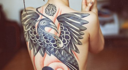 Amazing full back phoenix tattoo