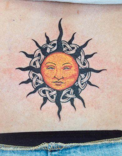 Celtic sun and knots back tattoo