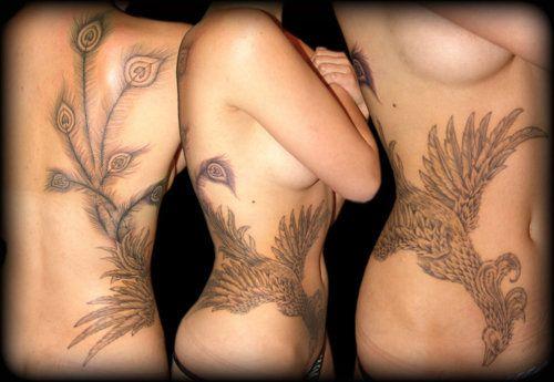 Girls black phoenix tattoo wrapping around her side