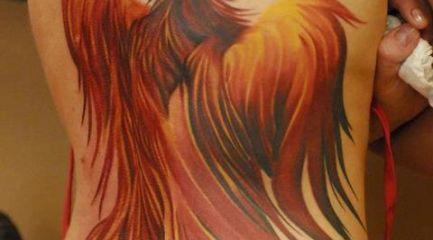 Girls full back phoenix tattoo in red orange and yellow