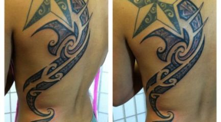 Girls Polynesian tribal back tattoo with star