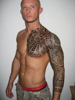 Guys chest and sleeve Polynesian tattoo with sun