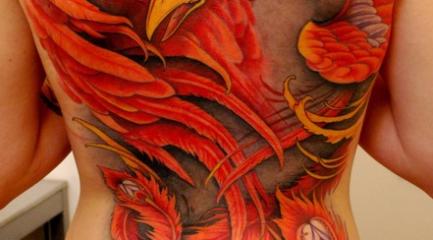 Huge fiery phoenix tattoo on guys back