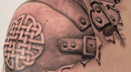 Intense shoulder armor tattoo with Celtic cross