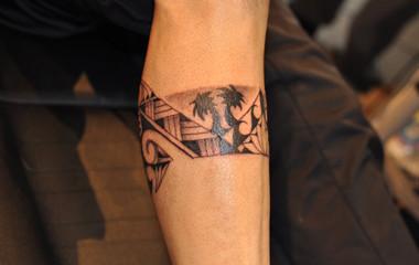 Polynesian leg band tattoo with palm trees