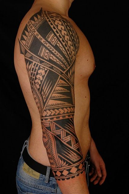 Polynesian three-quarter tribal sleeve tattoo
