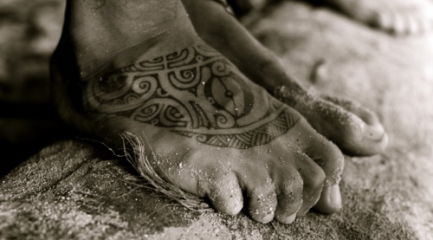 Polynesian tribal foot tattoo