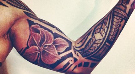 Shoulder and sleeve Polynesian tattoo with flower